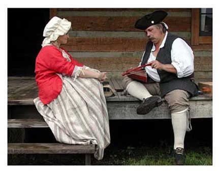 Reenactor plays psaltry at Fort Randolph